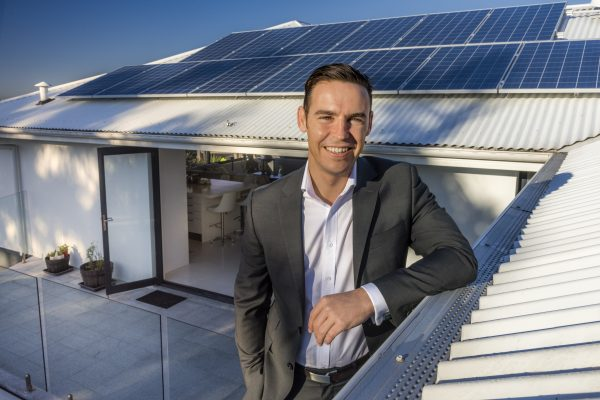 Evergen home storage featuring solar panels and Emlyn Keane, Operations Manager from Evergen